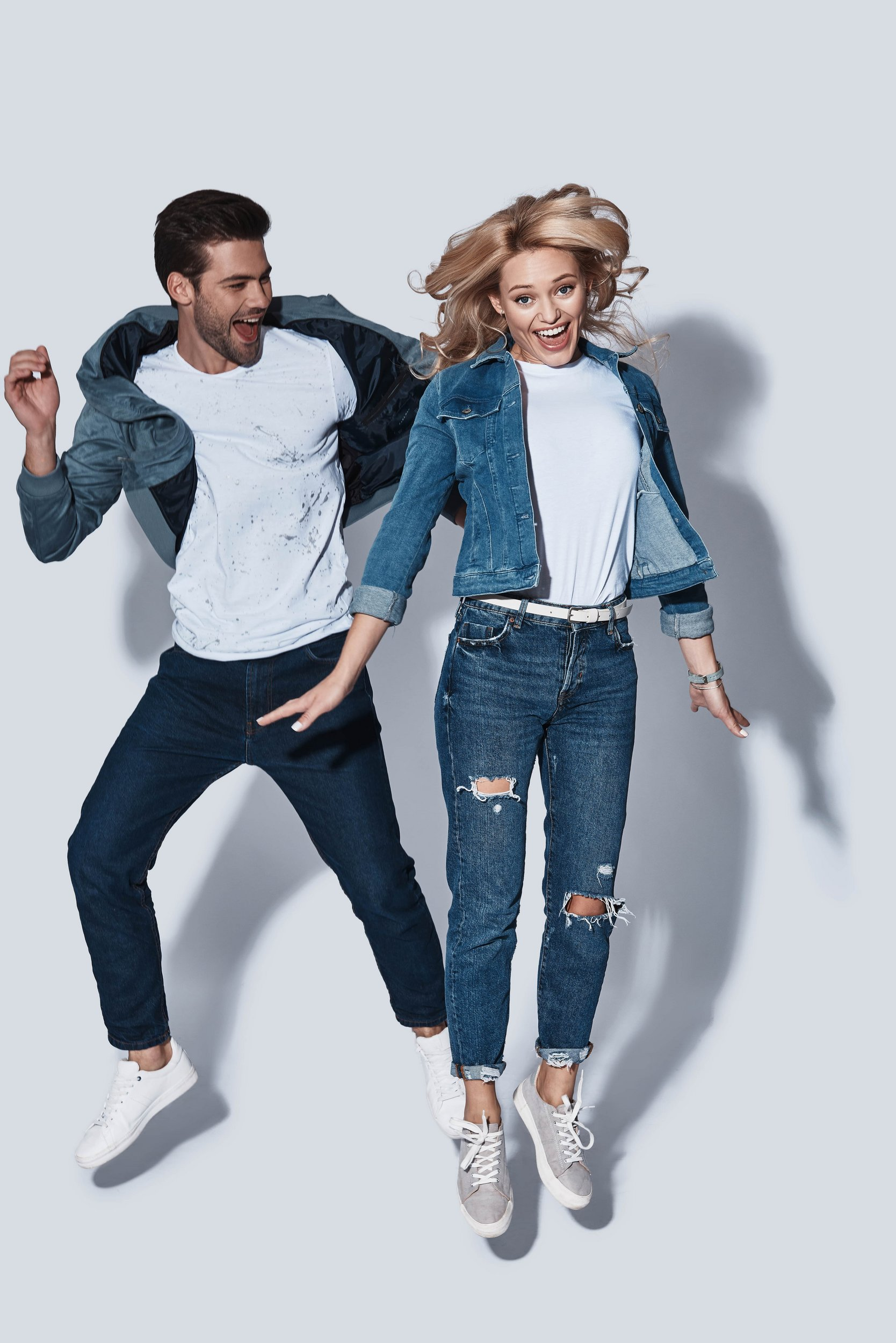 Jeans and shirts of happy couple